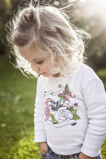 Close up of female toddler with hands in pockets - CUF33249