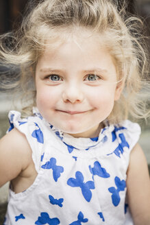 Close up portrait of female toddler in butterfly dress - CUF33255