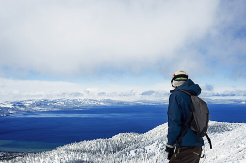 Young male hiker enjoying view, Lake Tahoe, California, USA - CUF33267