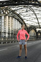 Young female runner exercising on bridge - CUF33378