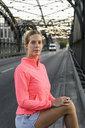 Portrait of young female runner on bridge - CUF33381
