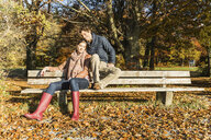 Couple sitting on bench - CUF33447