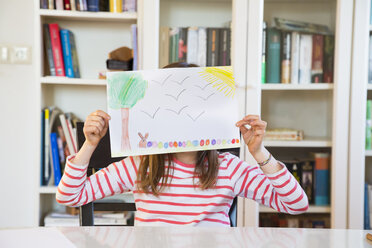 Little girl hiding her face behind her Easter bunny painting - LVF07130