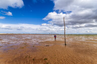 United Kingdom, Northumberland, posts marking the pilgrims' way crossing to Lindisfarne - SMAF01034