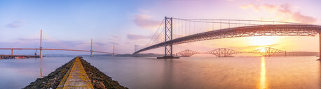 United Kingdom, Scotland, Firth of Forth, Forth Road and Rail Bridges and the new Queensferry Crossing Bridge at sunrise - SMAF01049