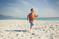 Boy running on beach, Cape Town, Western Cape, South Africa - CUF33709