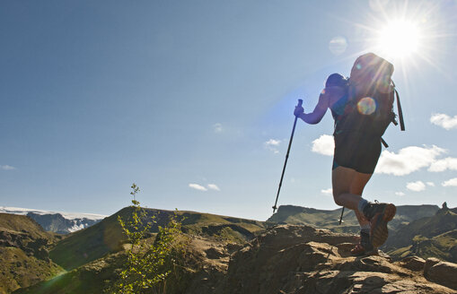 Woman hiking up to Fimmvordurhals Pass above Thorsmork Valley, Thorsmork, South Iceland, Iceland - CUF33727
