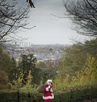 Santa Claus carrying sack over shoulder - CUF33769