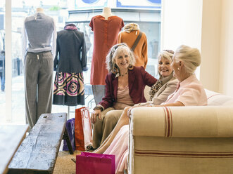 Senior women taking a break in boutique - CUF33820