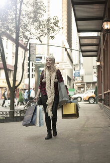 Young woman with shopping bags, New York City, USA - CUF33953