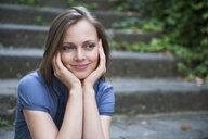 Woman sitting on step - CUF33989