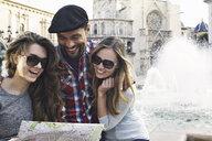 Tourist friends looking at map, Plaza de la Virgen, Valencia, Spain - CUF34001