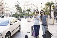 Two young female friends out shopping, Valencia, Spain - CUF34052