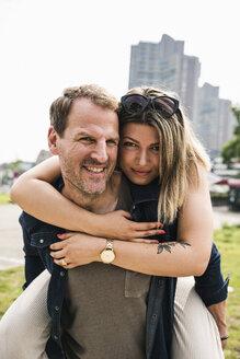 Portrait of happy couple in the city - UUF14297