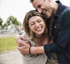 Happy couple having fun outdoors - UUF14300