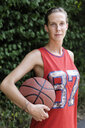 Portrait of young female basketball player in park - CUF34236