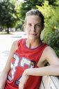 Portrait of female basketball player taking a break in park - CUF34239