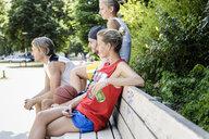 Group of basketball friends taking a break in park - CUF34440