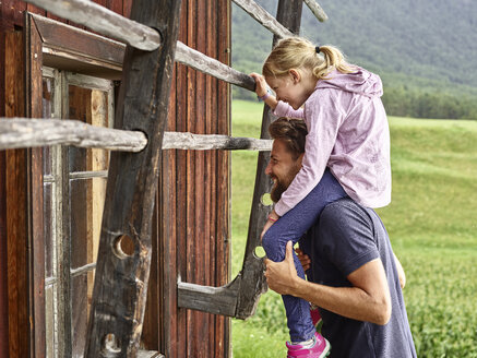 Happy father and daughter at wooden hut in the countryside - CVF00866