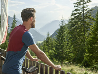 Austria, Tyrol, Mieming, man looking at view in the mountains - CVF00872
