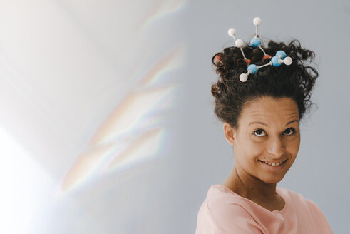 Young woman with molecule model in her hair - KNSF04054