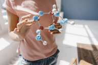 Female scientist holding molecule model - KNSF04057