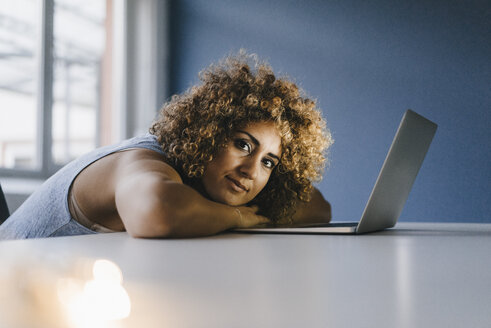 Woman working overtime in her start-up business - KNSF04186
