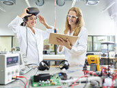 Female technicians working with tablet and vr glasses - CVF00879