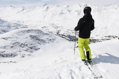 Mid adult man looking at downhill, Obergurgl, Austria - CUF34618
