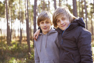 Portrait of twin brothers in forest - CUF34642