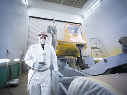 Portrait of paint spray technician in truck repair factory - CUF34931