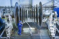 Engineer measuring low pressure steam turbine parts in repair works - CUF34961