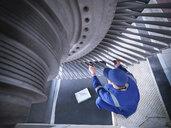 Engineer inspecting steam turbine in repair works - CUF34982