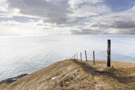Handrail on edge of sea cliff, Hofsos, Iceland - CUF35090