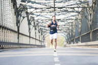 Jogger crossing bridge - CUF35111