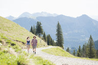 Mid adult couple walking through Tegernsee, Bavaria, Germany - CUF35396