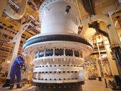 Engineer adjusting seawater valve in power - CUF35408