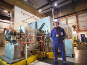 Portrait of engineer in generator room of power station - CUF35420