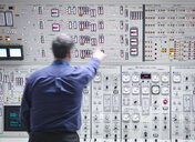 Operator adjusting controls in nuclear power station control room simulator - CUF35429