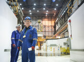 Portrait of engineers in reactor hall in nuclear power station - CUF35522