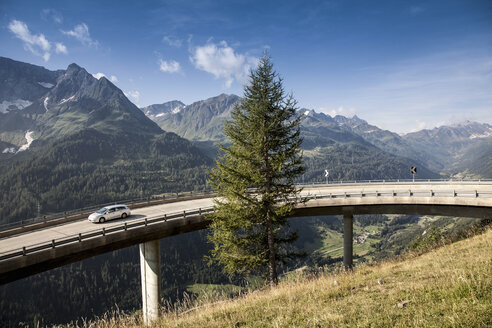 Car on elevated highway to Gotthard Pass, Switzerland - CUF35534