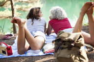Mother and daughter on picnic blanket by the Blue Pool, Wareham, Dorset, United Kingdom - CUF35783