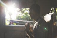 Thailand, Bangkok, tourist travelling, holding camera - WPEF00478