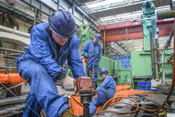 Engineer drilling during power station outage - CUF36052