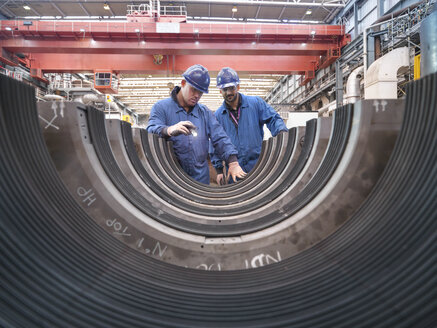 Engineers inspecting turbine housing during power station outage - CUF36103