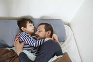Father and son in bed - CUF36154