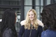 Young women talking - CUF36172