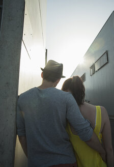 Rear view of young couple in street - CUF36286