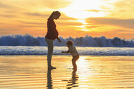 Mother and toddler son playing on beach at sunset, San Diego, California, USA - ISF14435
