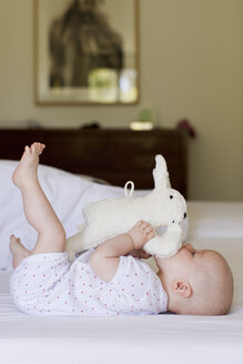 Baby girl playing with soft toy - CUF36756